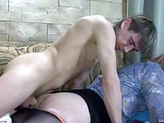 Sleeping guy getting his equipment blown and prepared for anal by a horny sissy
