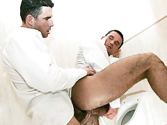 Student assistants Tim Brown and Stick Stevans fuck in a bathroom