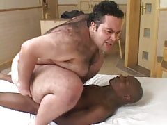 Horny bear gay rides huge black cock