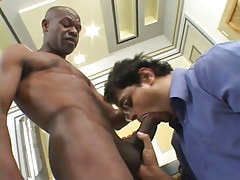 Hairy gay sucks chocolate cock in dining room