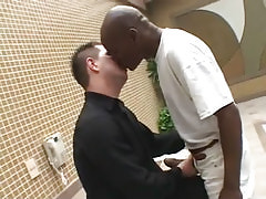 Interracial gays kiss by pool