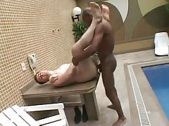 Poor guy drilled by black gay on table