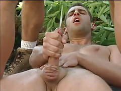 Three muscle gays jizz by turns in forest