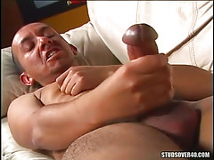 Gay with big cock masturbates