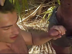 Hairy gay gets cum in tropic forest